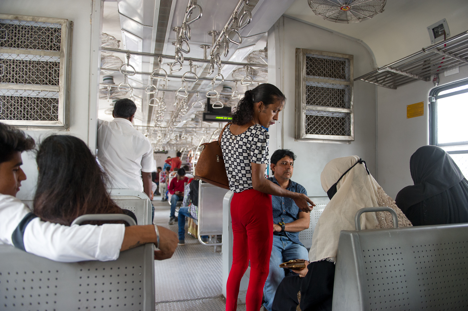 Transgender collecting donations on a local train, Mumbai, 2019