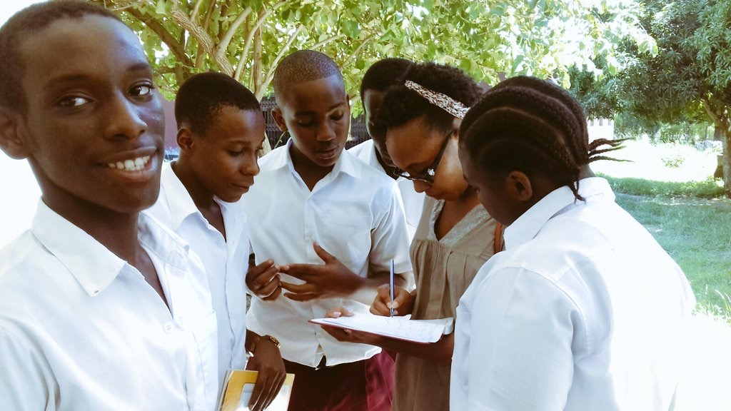 2017 Caine Prize workshop writer, Darla Rudakubana, with students from Nianjema High School