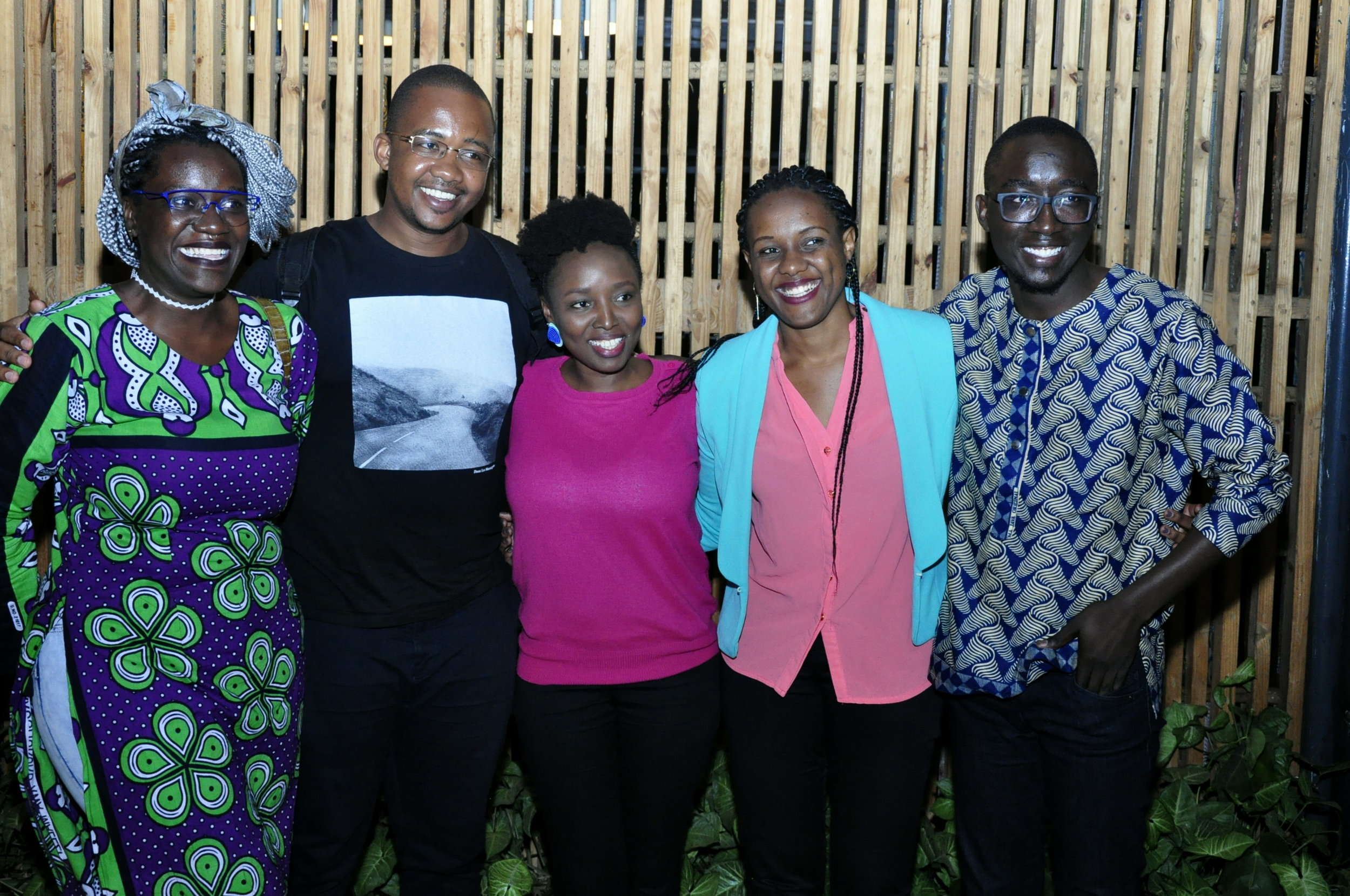 2018 Caine Prize workshop participants Awuor ,   Bongani, Caroline and Troy posing with Louise Umutoni (founder of Huza Press). Image courtesy of Huza Press.