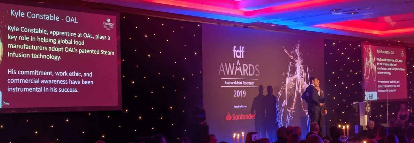 Kyle winning Apprentice of the Year at FDF awards.jpg