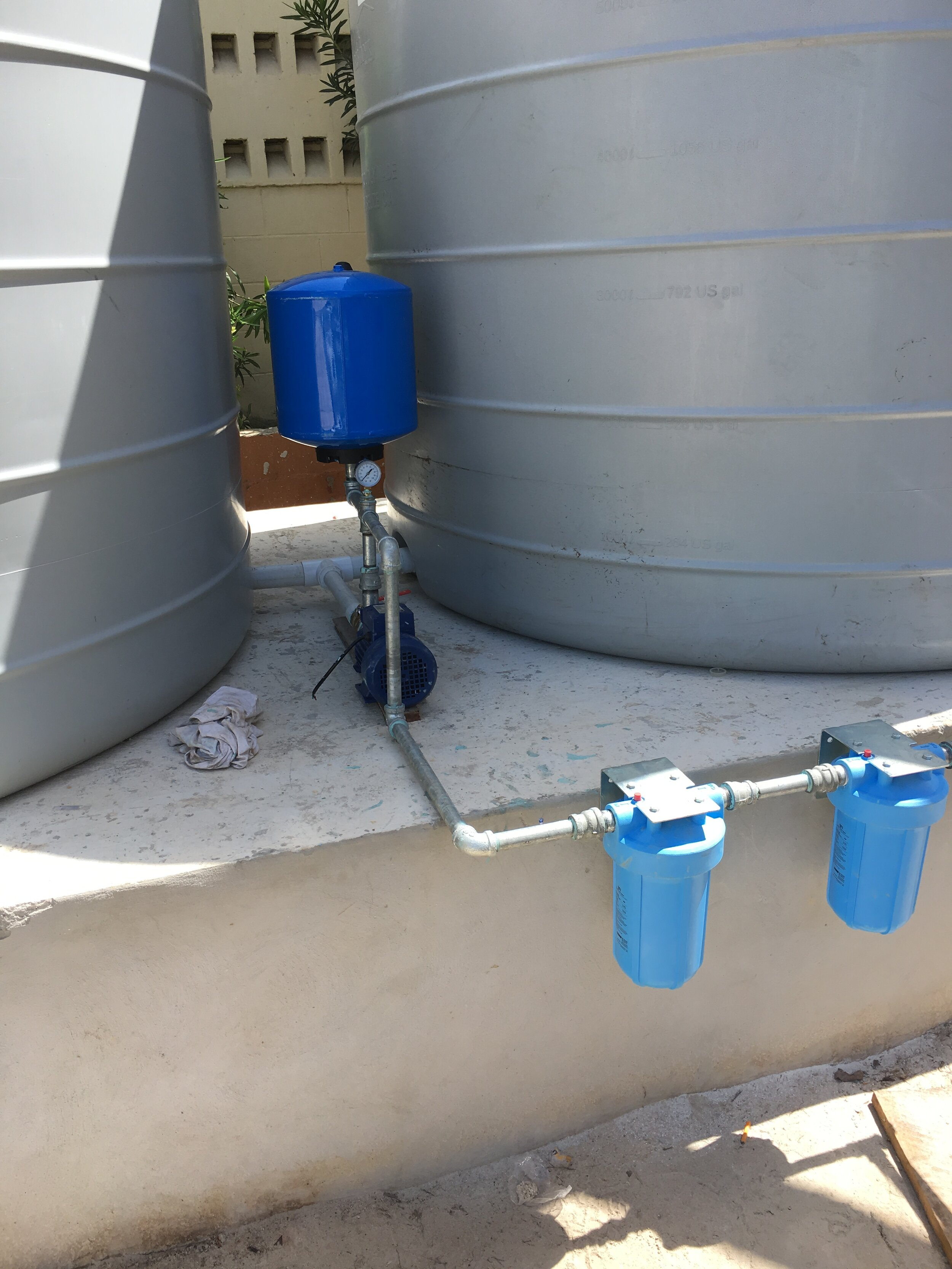 Four new rainwater vats with a filtering system are providing St. Martin's students with increased access to clean water.