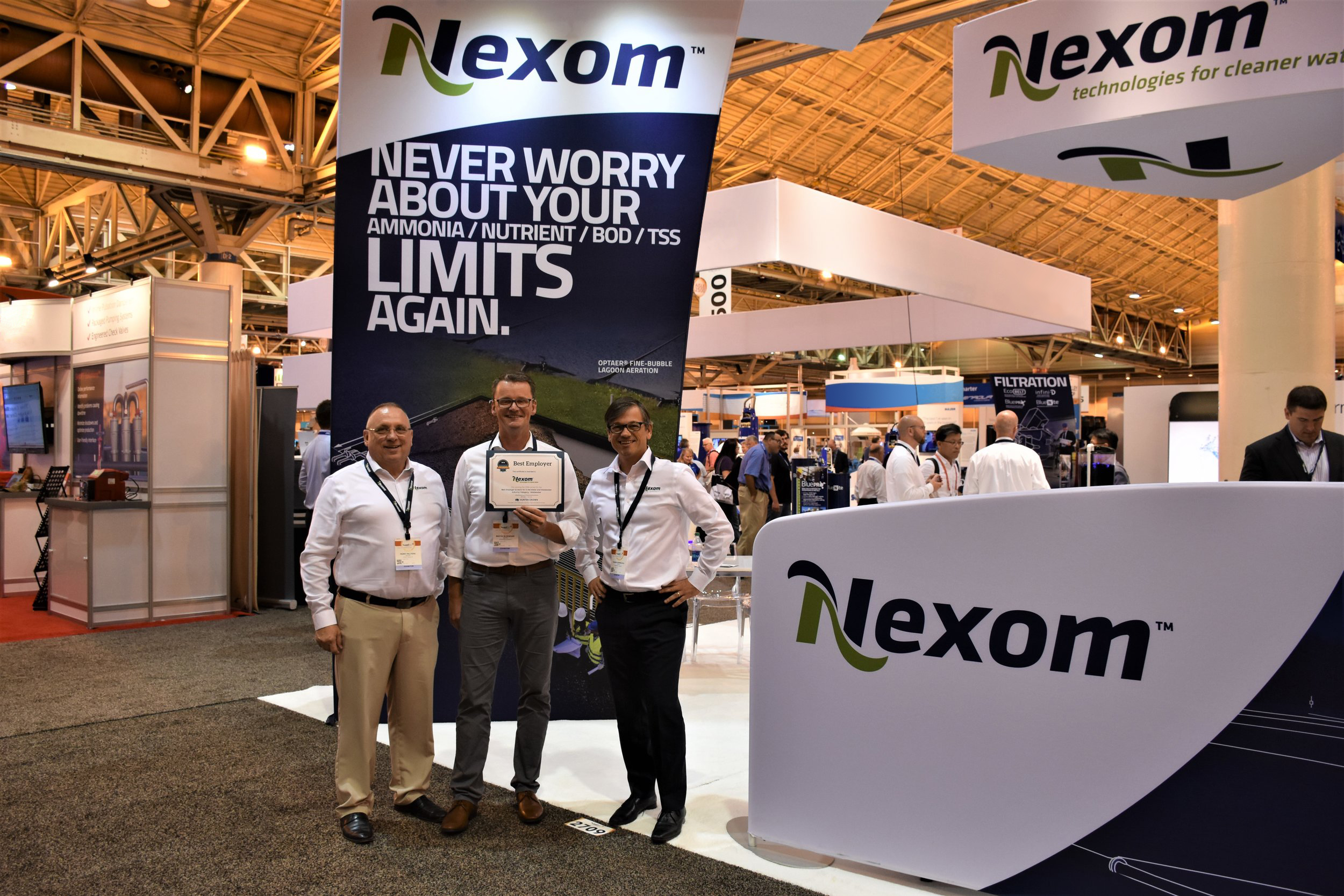 Perry Pelitera (Regional Sales Manager), Martin Hildebrand (President), and Francis Bordeleau (Vice President, Sales & Marketing) accept the 2018 Best Employer Award presented by Hunter Crown at WEFTEC 2018 in New Orleans.