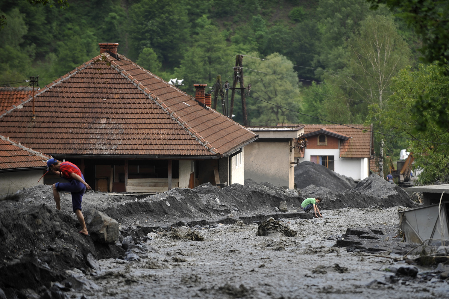 A view of a landslide and floodwaters around houses in the village of Topcic Polje near Zenica.