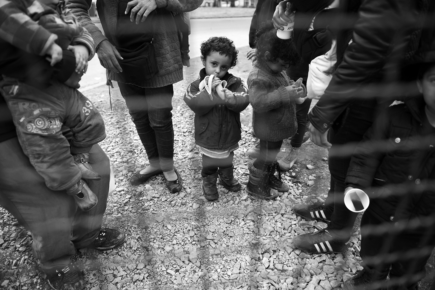 A child is standing in line with family before registering at the reception center in Opatovac, near the town of Tovarnik where Croatian police registered refugees from the Middle East who have come from Serbia. After registering, the refugees continue their way to Slovenia, most refugees want to get to Germany.