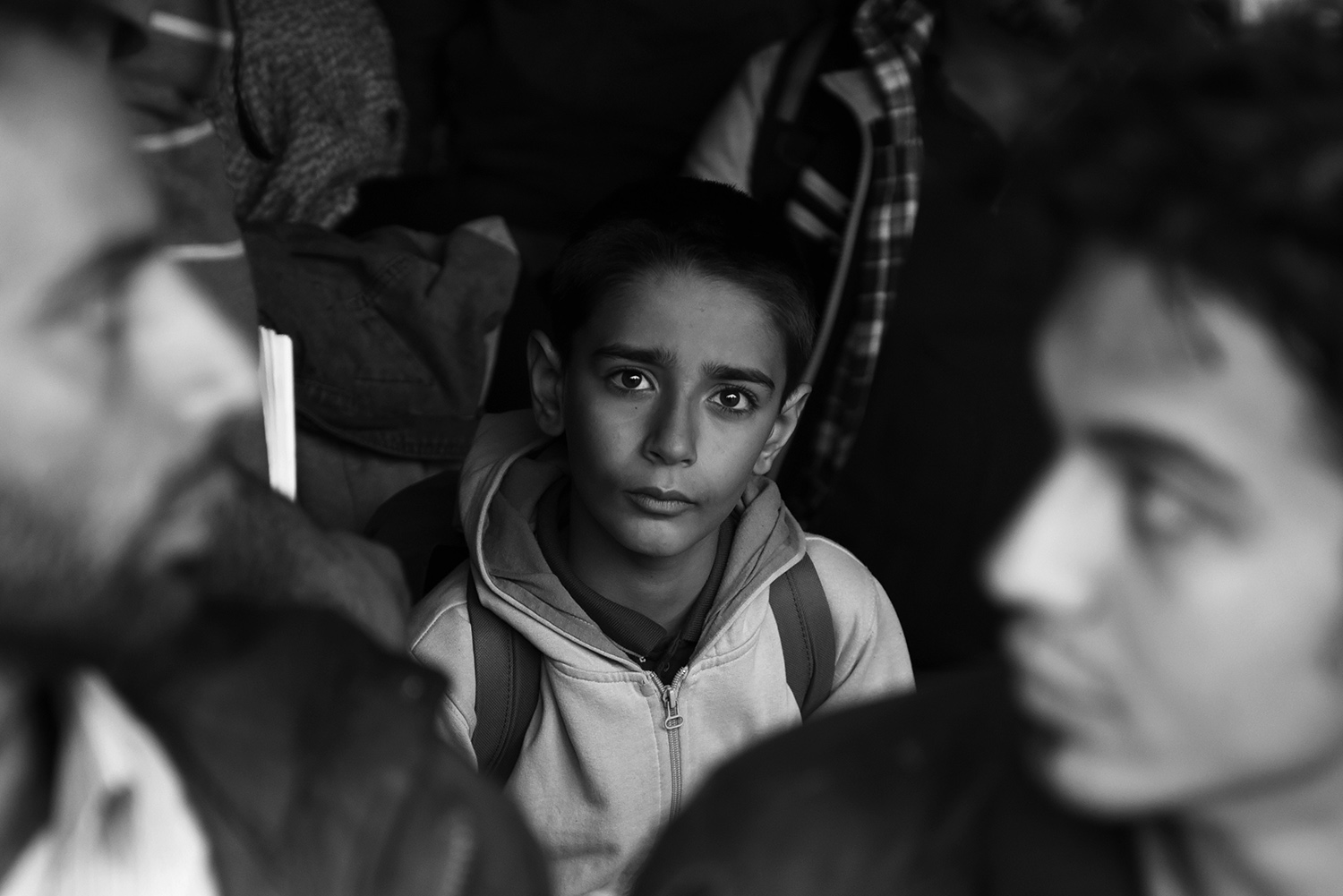 The boy is standing in the crowd before registering at the reception center in Opatovac, near the town of Tovarnik where Croatian police registered refugees from the Middle East who have come from Serbia. After registering, the refugees continue their way to Slovenia, most refugees want to get to Germany.