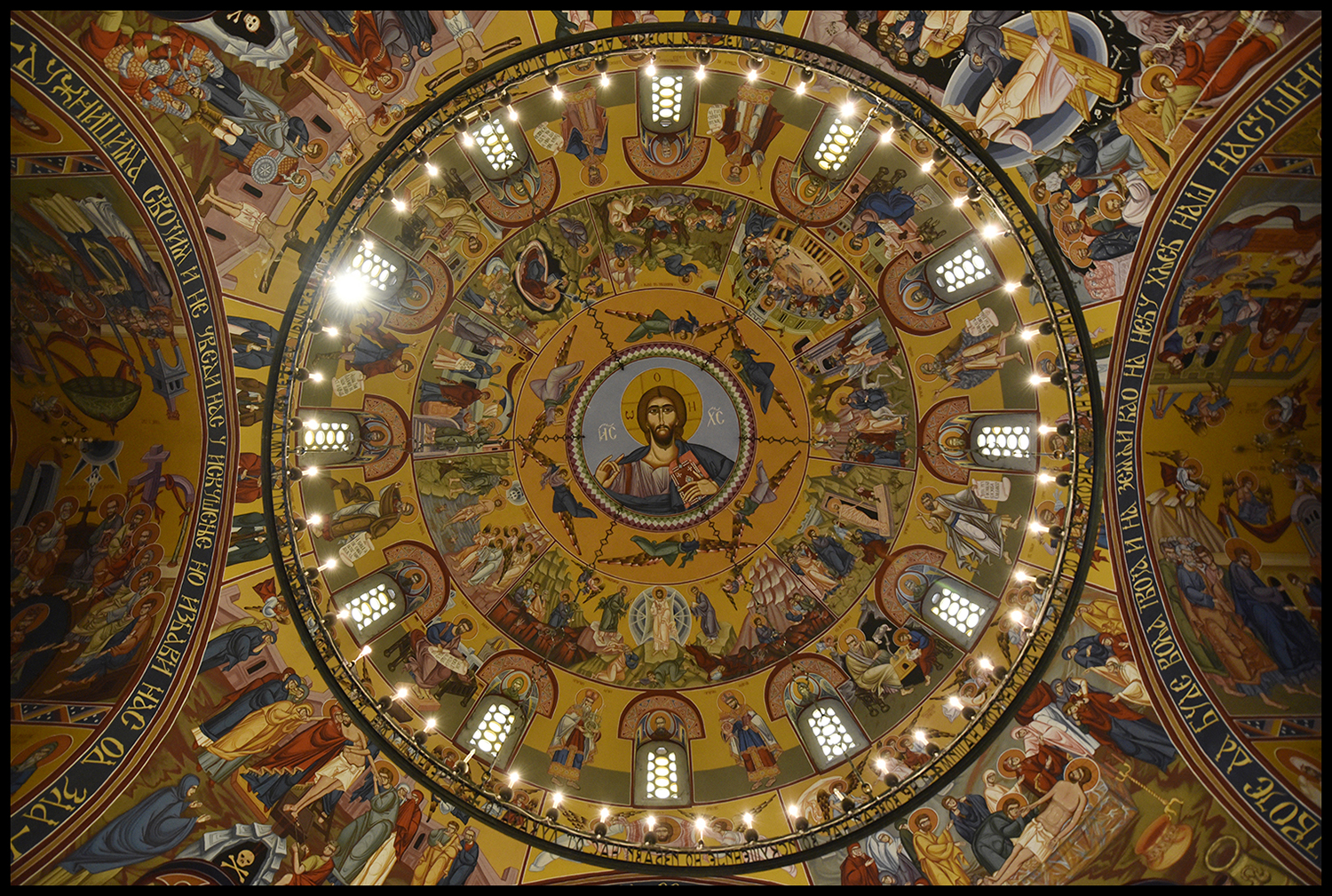 View of the beautiful painted ceiling of the Temple/Church of the Holy Transfiguration in Sarajevo, Bosnia and Herzegovina. This Serbian Orthodox church was built in 1940 by Aleksandar Deroko, the project was initially made for Split in Croatia, that's why the church looks like a places of worship on the Adriatic coast. Sarajevo, Bosnia and Herzegovina