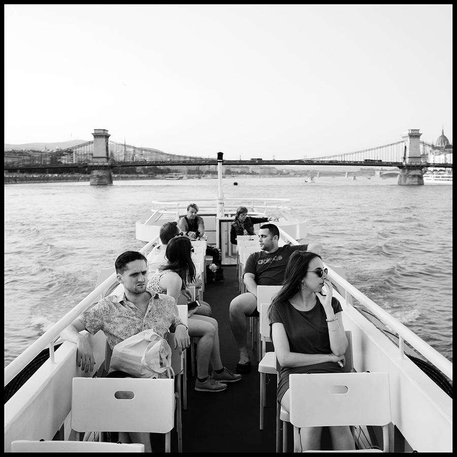 Tourists on a boat during cruise on the river Danube, here you can hear  fabulous stories about the charming sights along the river.