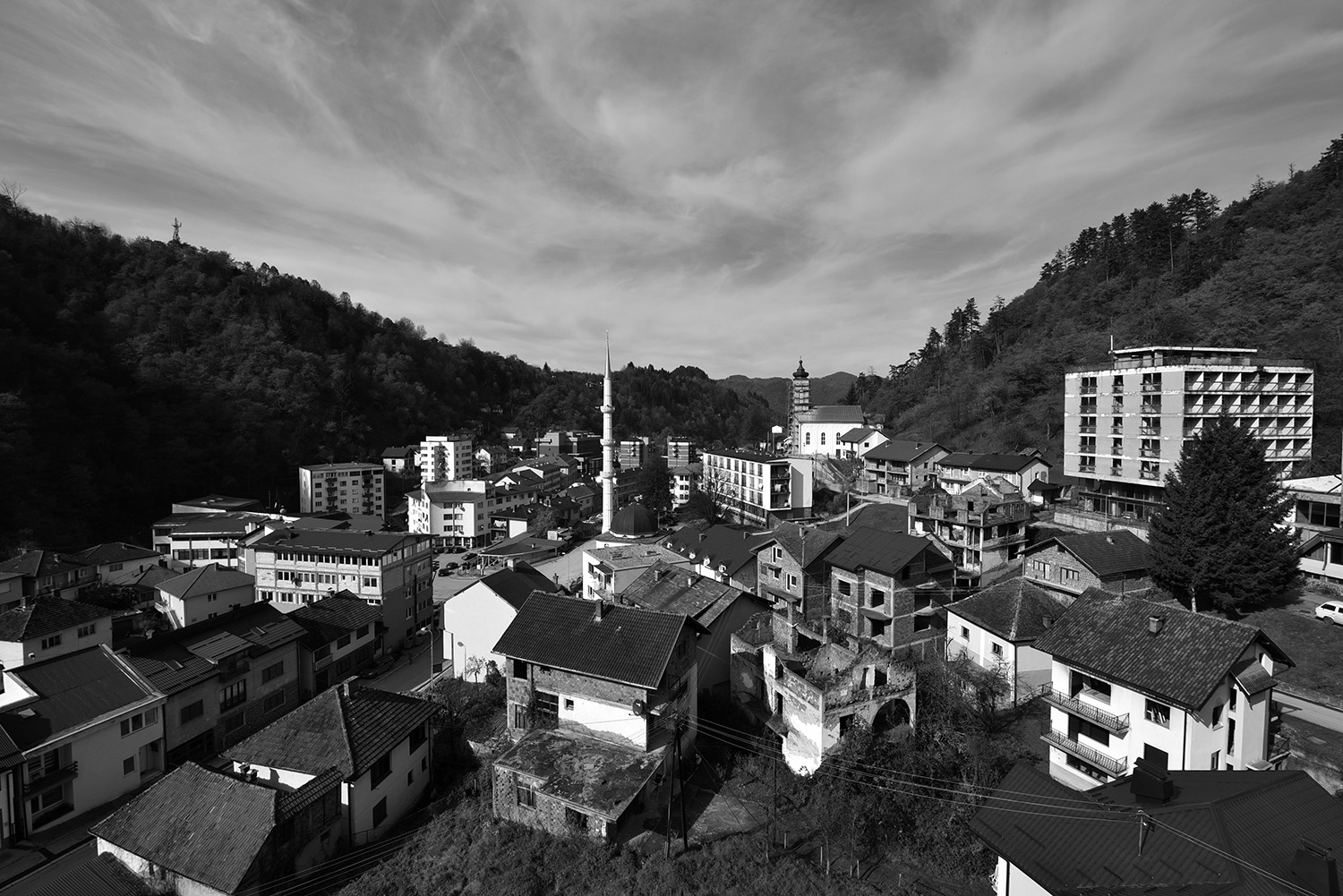 View on the Srebrenica, eastern Bosnian town, 150 kilometers northeast of Bosnia and Herzegovina's capital city of Sarajevo. Srebrenica gained global notoriety and became a symbol of Bosniak suffering following the slaughter of more than 8,000 Bosniak men and boys in 1995. Compare the results of the population census from 2013 with those from 1991, Srebrenica has lost 23,257 people (63.43 percent).