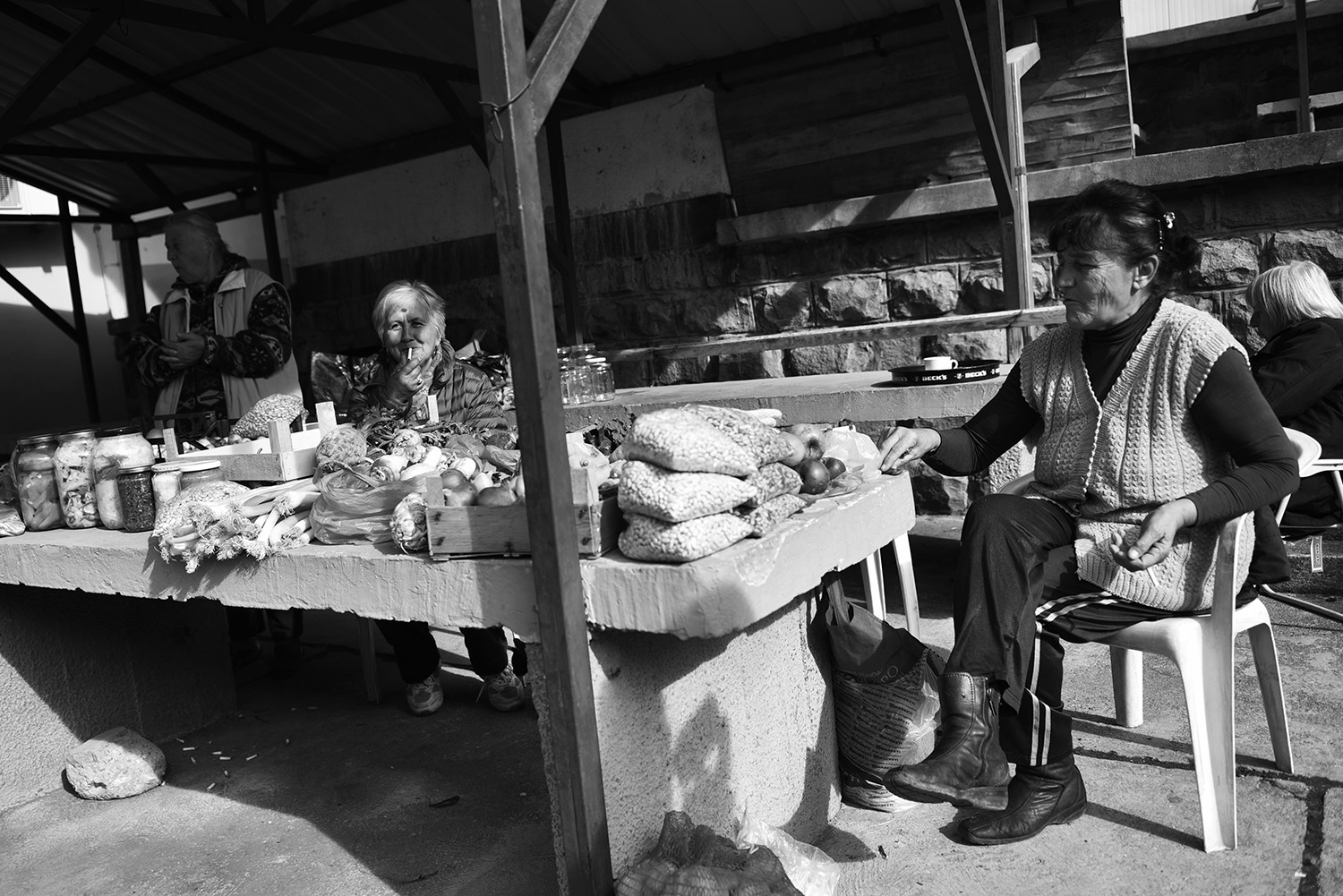 In the city center at the market stall is just one stand with fruits and vegetables. Bosniak Abida Karim (2nd L) from Bratunac every Monday, the last fourteen years comes to Srebrenica, only she has a stand at the market stall. For her, nothing has changed. It is difficult, she says, she lives from the sale in the market stall, she had to feed two families.