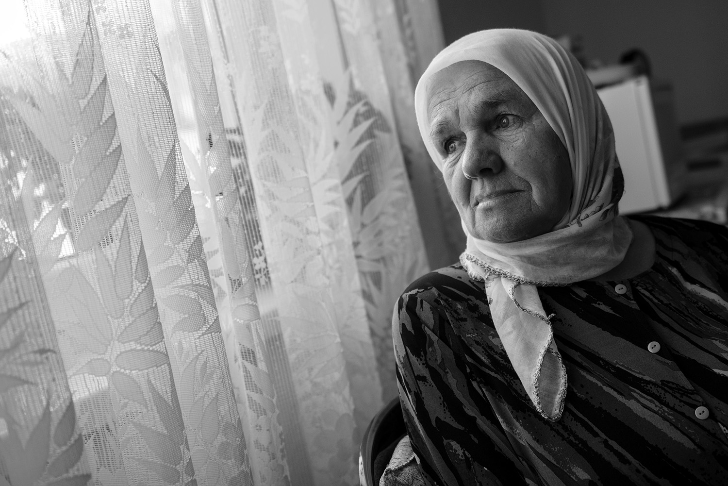 Meira Dogaz (Bosniak) lives near the Memorial Center in Potocari, her sons are buried there. In the genocide, she has lost three sons and husband. She does not believe Mladen Grujicic can take care of the memorial center and Bosniaks.