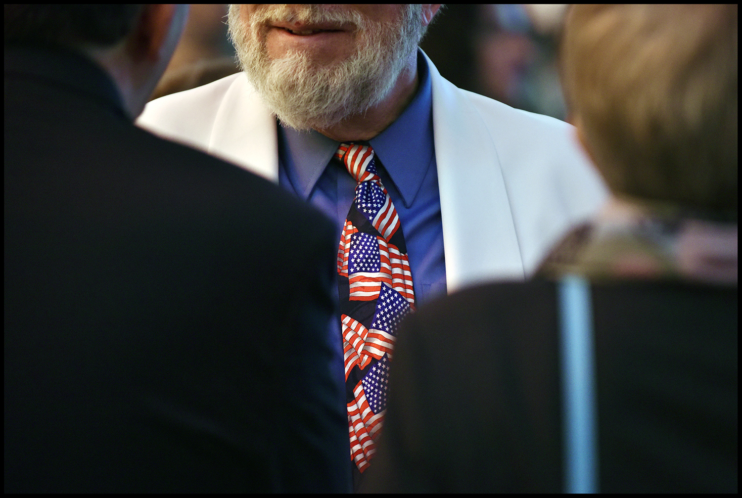 "A man wears a tie which is in the colors of the American flag. On the day of the presidential election in the United States, the US Embassy in Bosnia and Herzegovina organized the ""Election Night"" in Sarajevo. During the evening, many guests of the Embassy of the United States have followed the progress of the presidential elections in the United States."