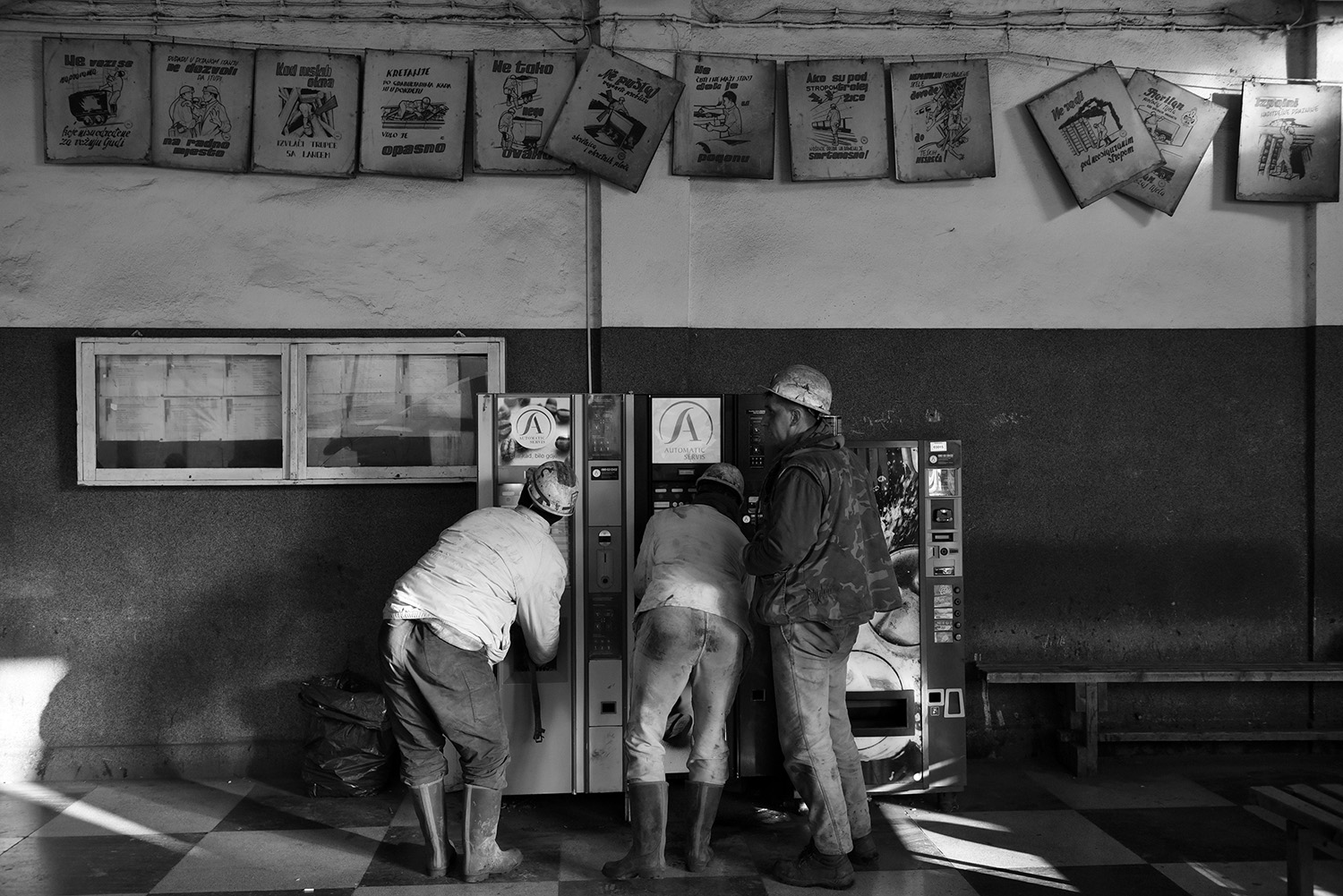 Coal miners take a coffee from a coffee machine after hard work.