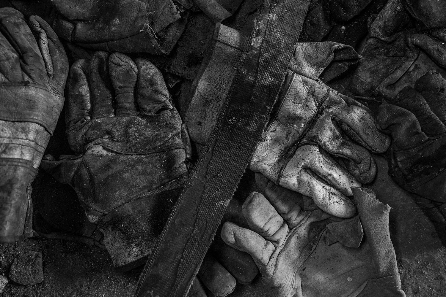 Belt and gloves of coal miners.