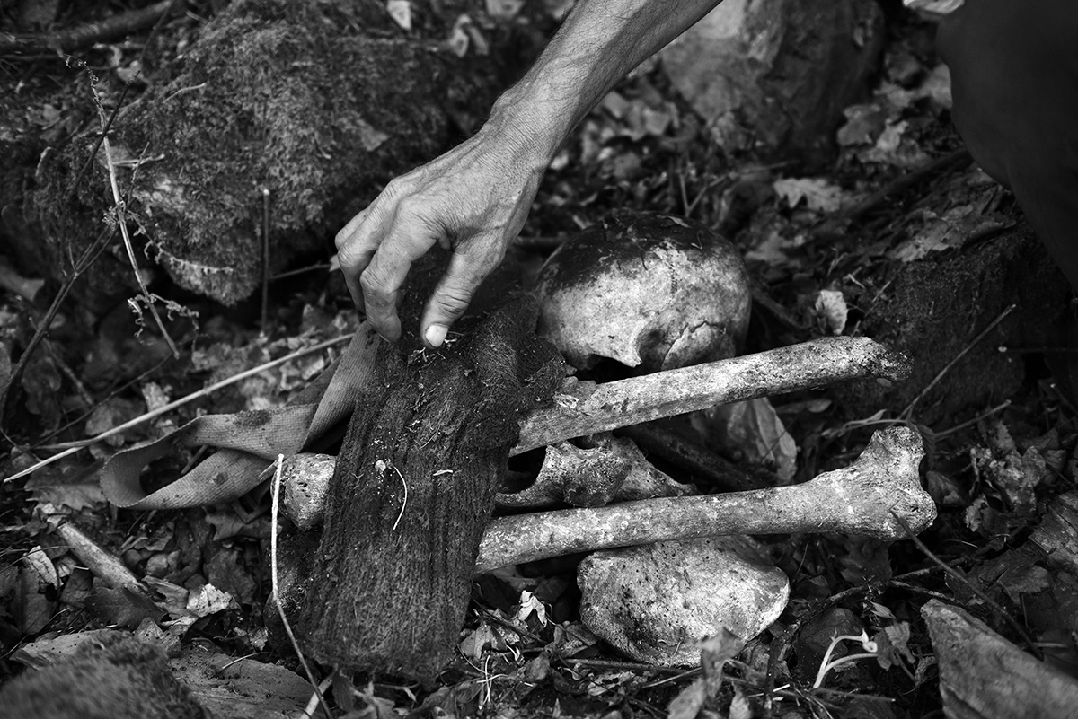 The remains of men from Srebrenica found by Ramiz Nukic, where Bosnian Muslim men tried to escape through the woods to free territory. When Ramiz uncovers new remains, he works with the ICMP to utilize their official identification processes. Kamenica, Bosnia and Herzegovina