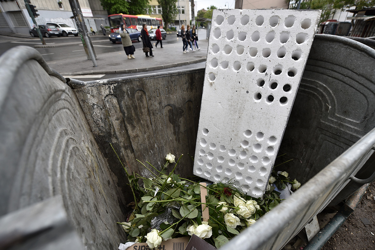 Only a few hours after the Dobrovoljacka Street commemoration ends, all roses and candles left behind by mourning family members are tossed aside as no official memorial site has been erected to house them. Sarajevo, Bosnia and Herzegovina.