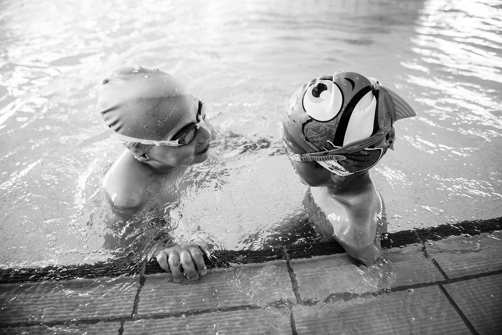 Ismail chats with a friend in the pool.