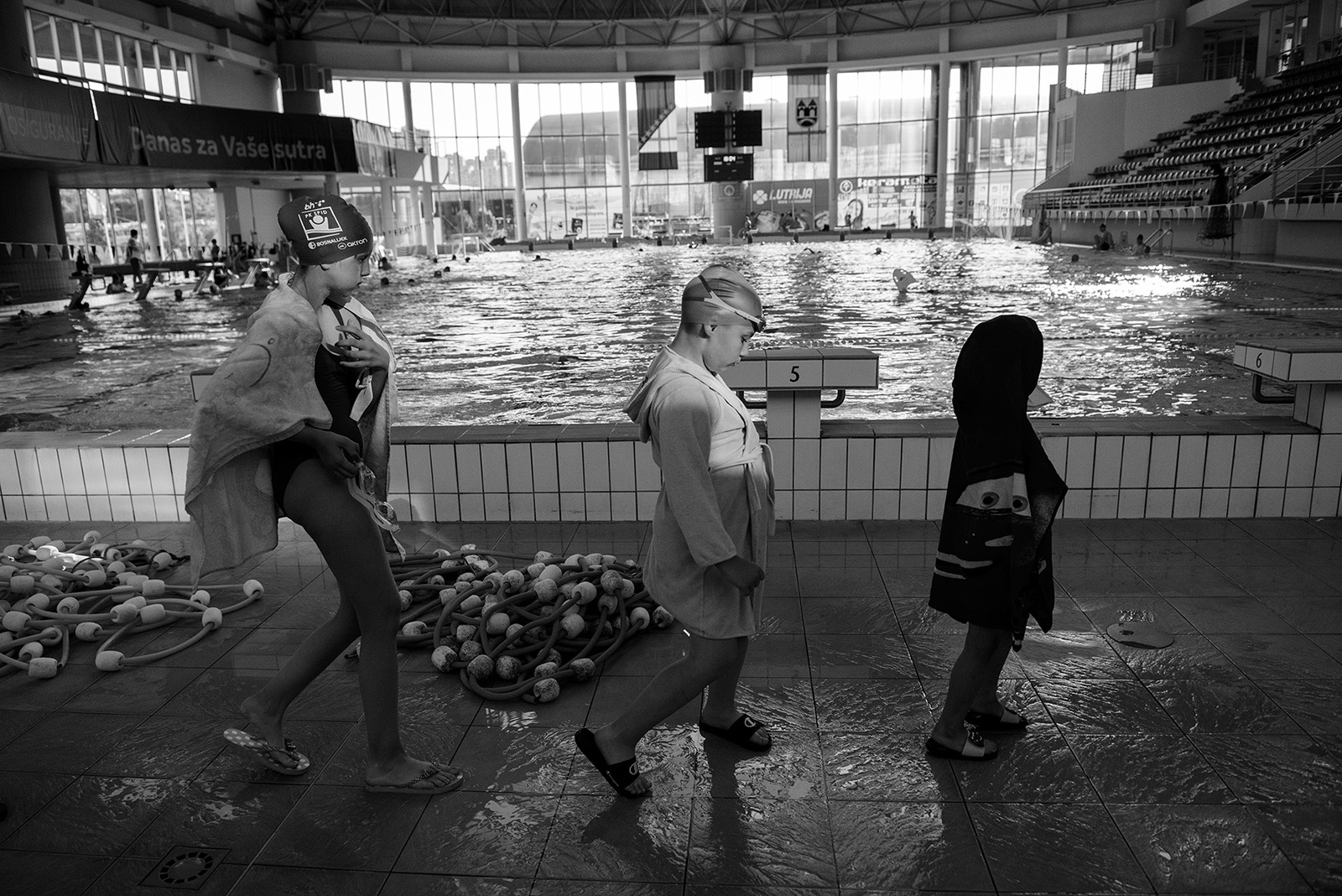 Children go to the dressing room after one-hour of training at the Olympic Pool in Sarajevo.