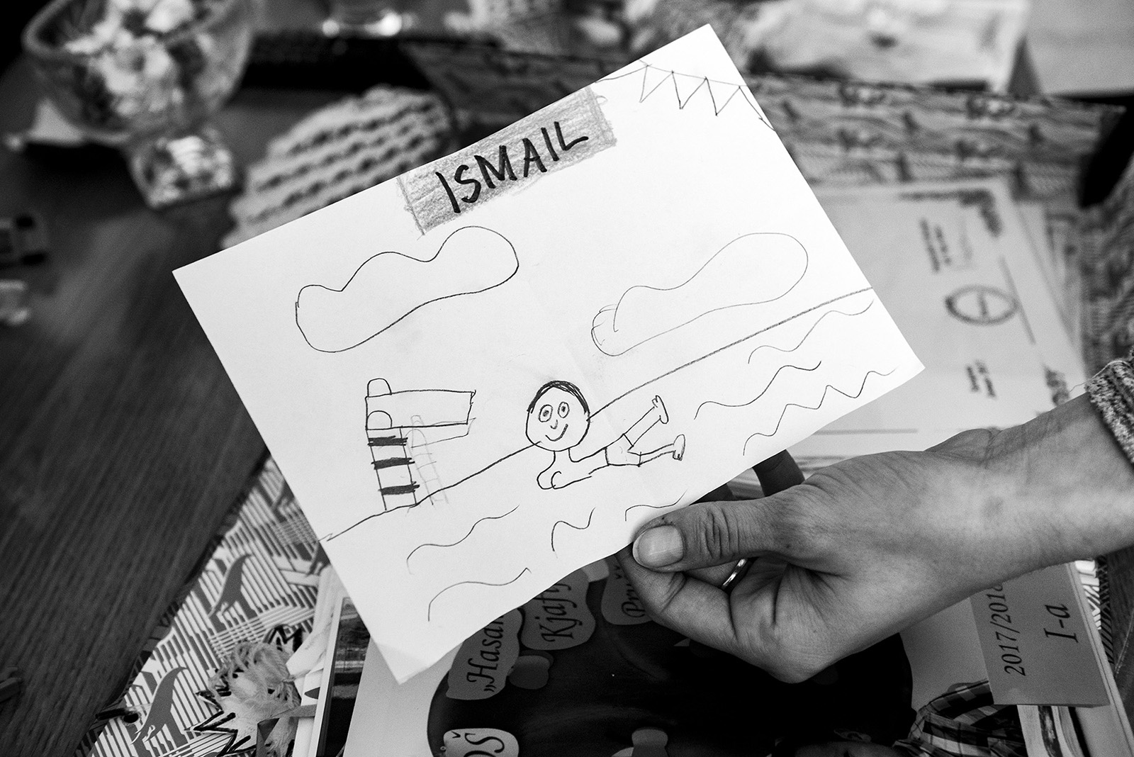 Elmina shows one of the drawings that Ismail got from a friend at school.