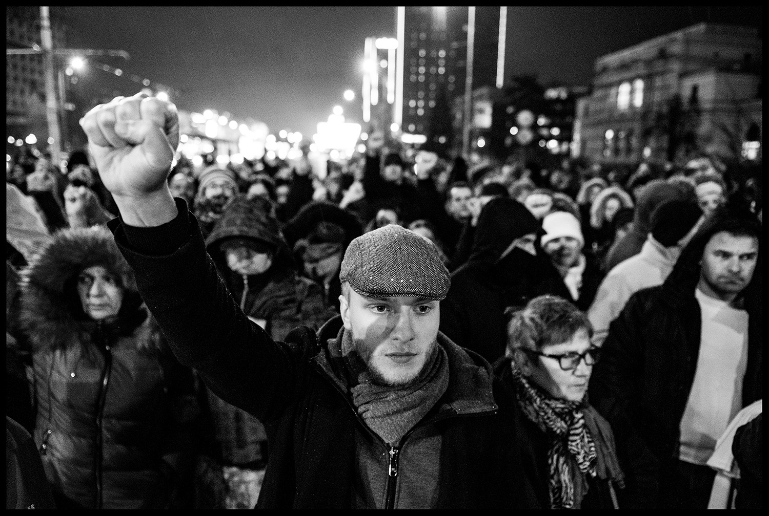 A man hold up a closed fist, a protest symbol Davor Dragicevic fight for justice.