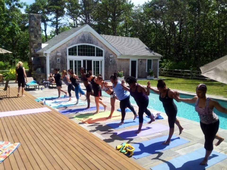 B.J. and friends at a poolside yoga session in martha's vineyard