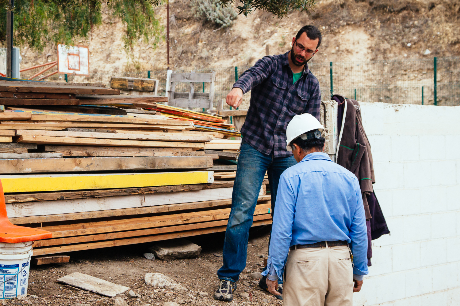 Dan engages with the community in Cañon Carretas by facilitating the construction of simple but sturdy (and colorful) homes.