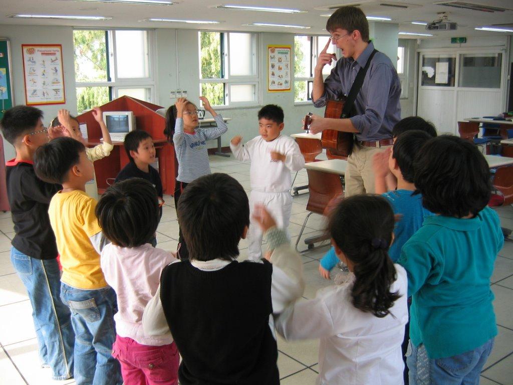 Austin having fun with a group of Korean kids.