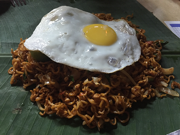 At a restaurant in Bangsar eating maggi goreng which is noodle, egg and spices. So delicious!