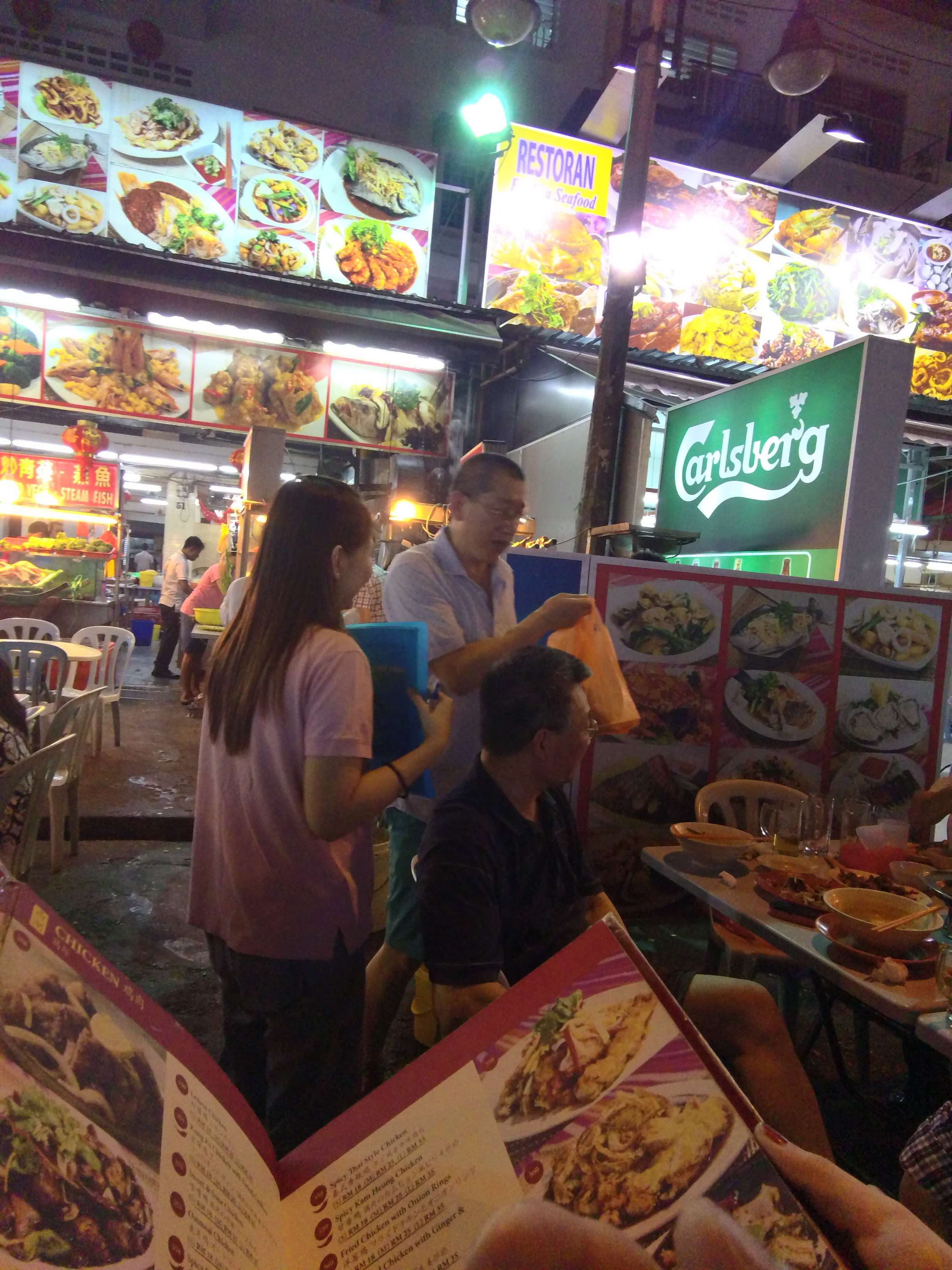 About to order food at a famous food stall in Jalan Alor