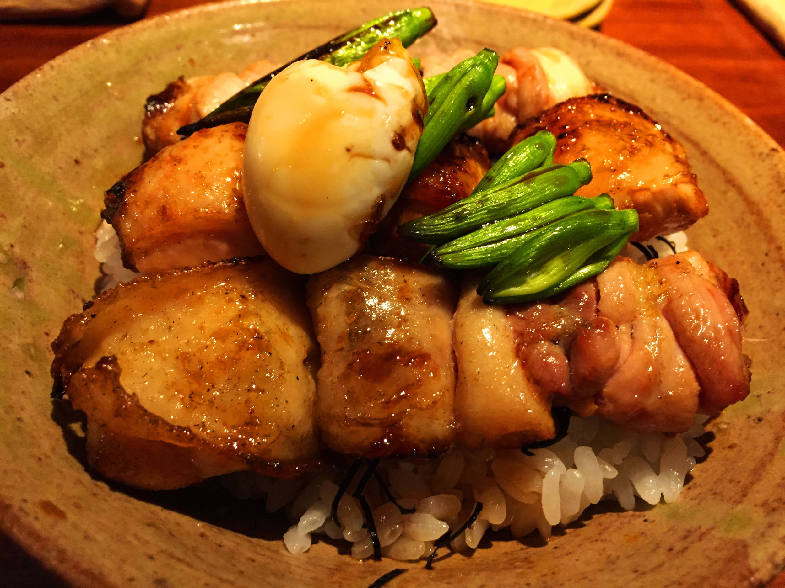 Eating Yakitori and rice which is called yakiudon