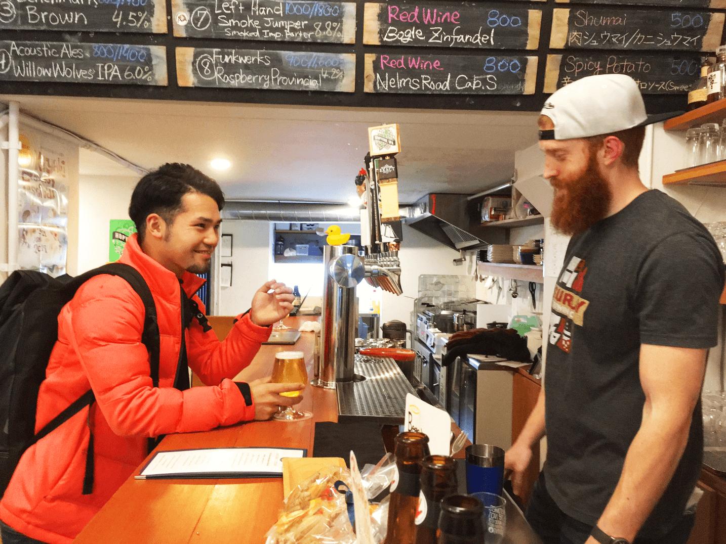 Adam serving a bar patron.