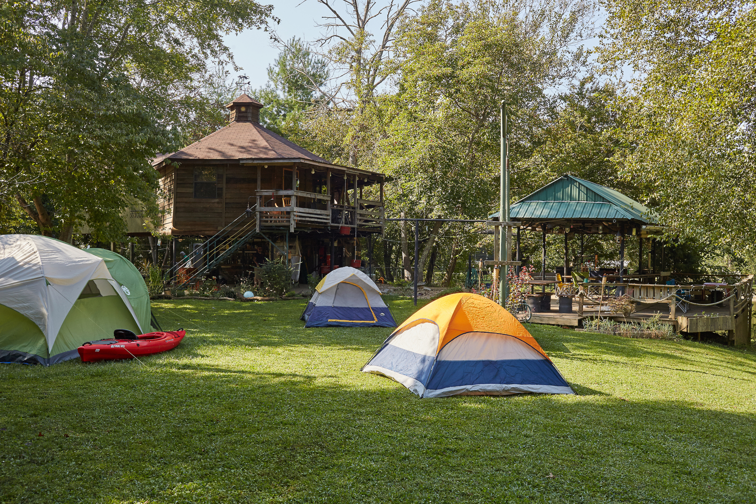 Tent Camping and Cabin Rental available next to a Shared Pavilion.
