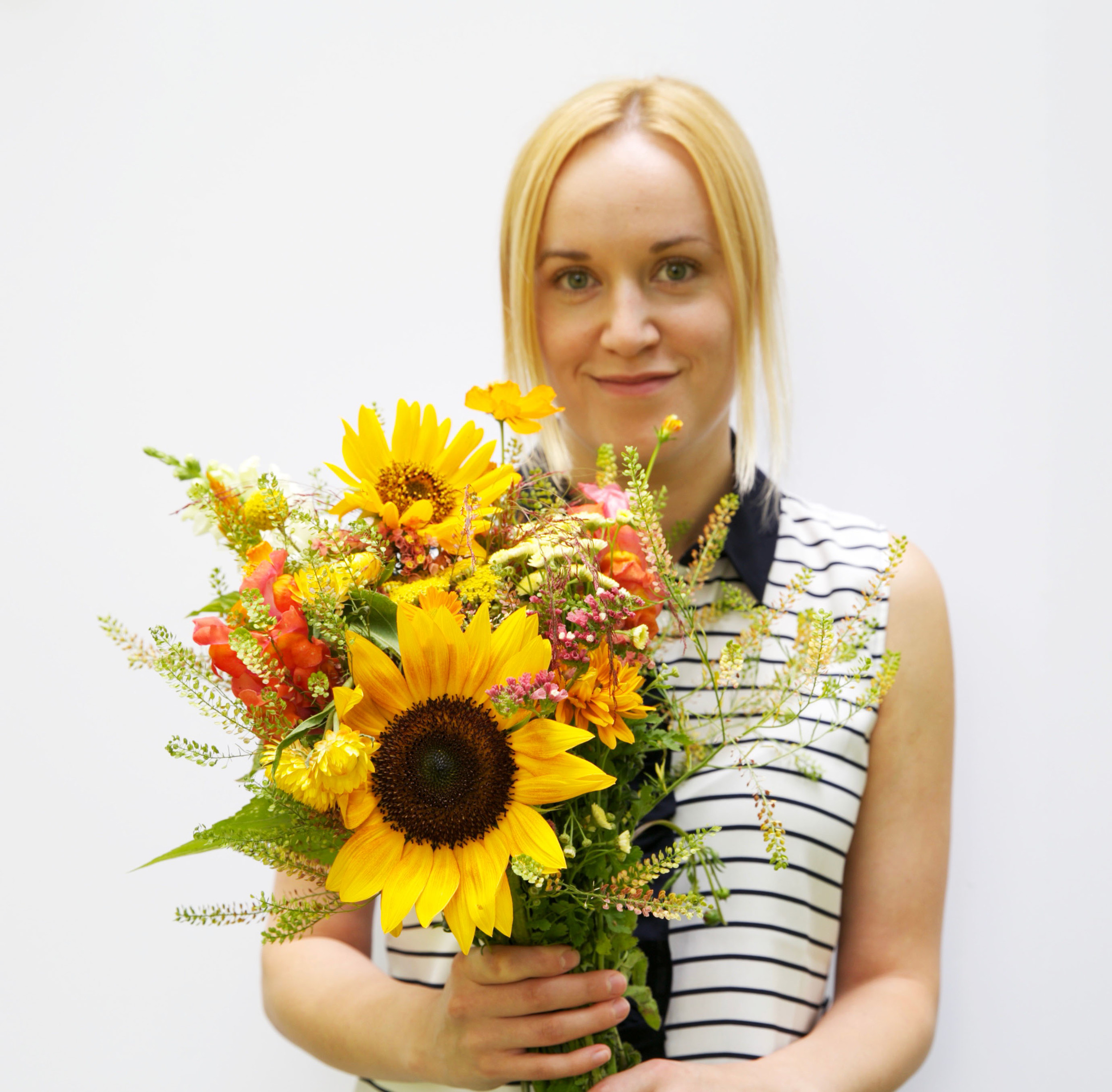 We asked our summer intern, Marta, to pose with the flowers since she matched them :)