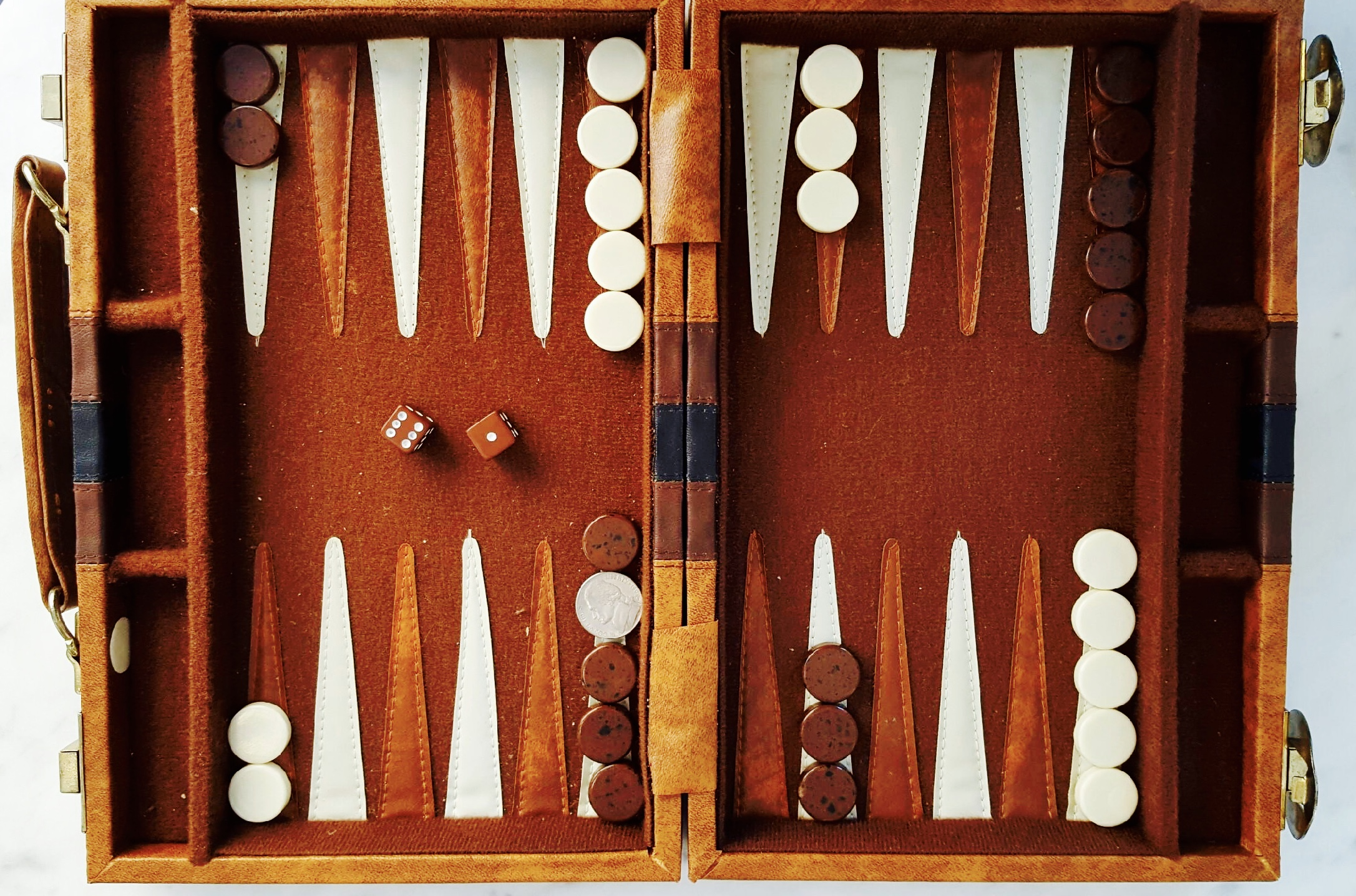 So was my backgammon game! I smoked Glenn and took the championship title home:)