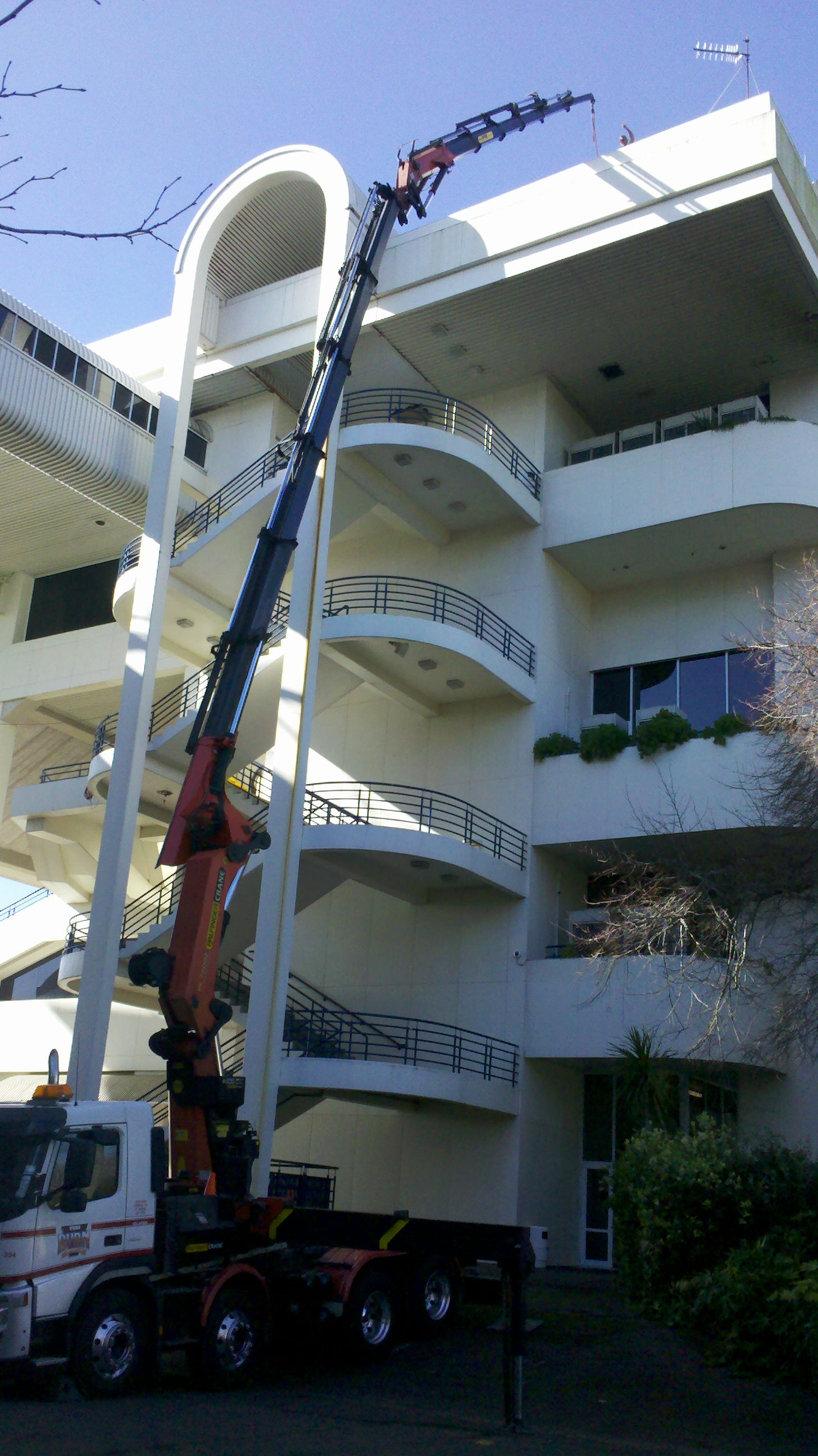 234 Crane lifting with Gib to roof of 4 story building.jpg