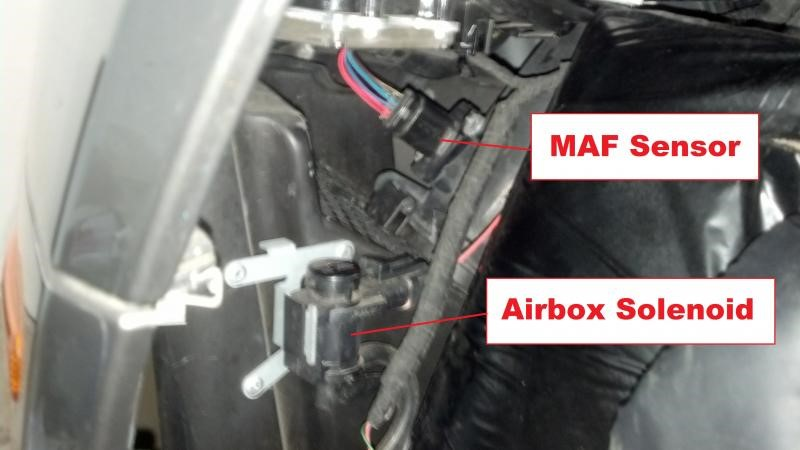 V8 Vantage airbox, flap solenoids, and MAF sensor harness plug.