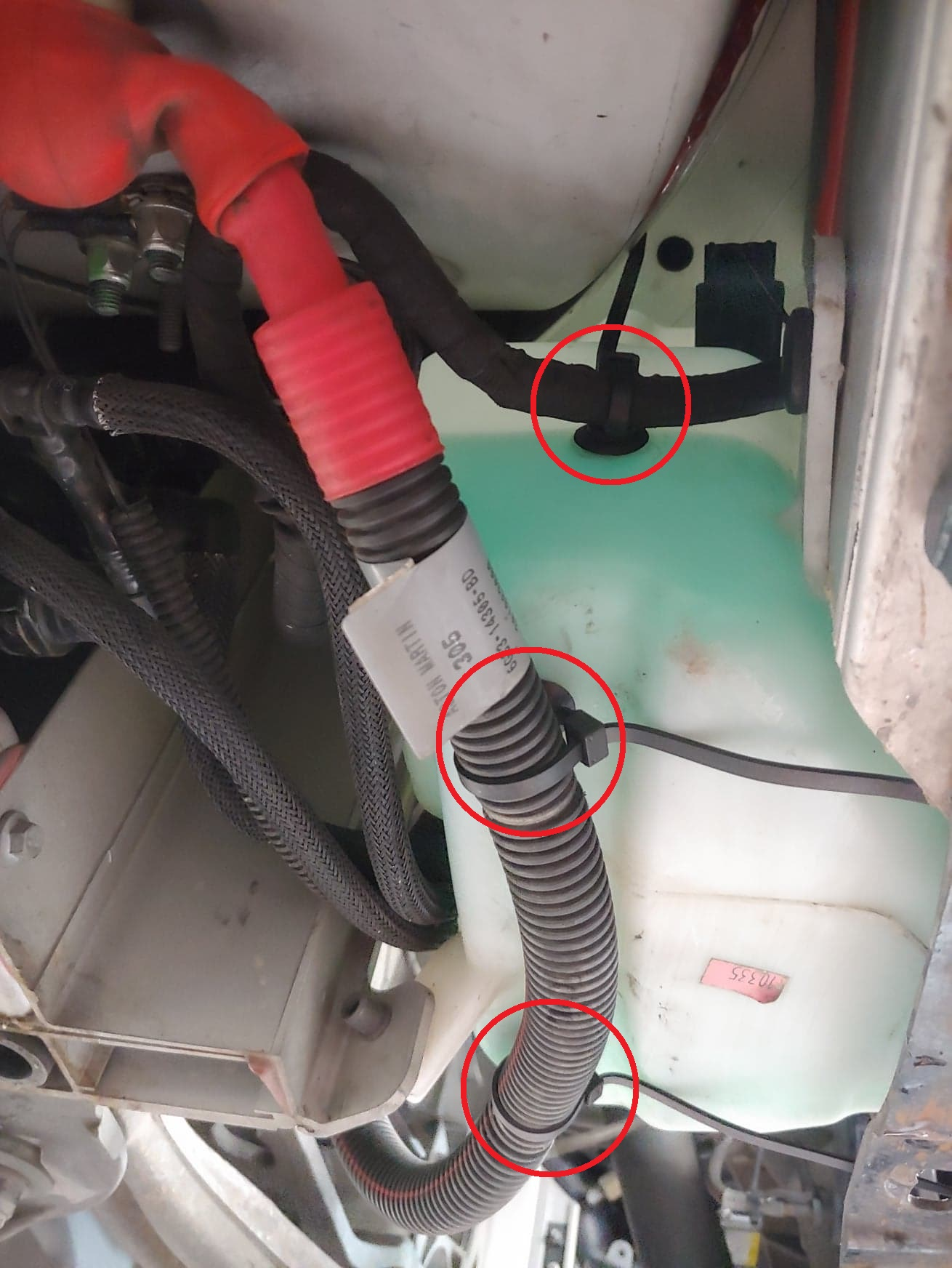 Washer tank starter cable zip ties.jpg