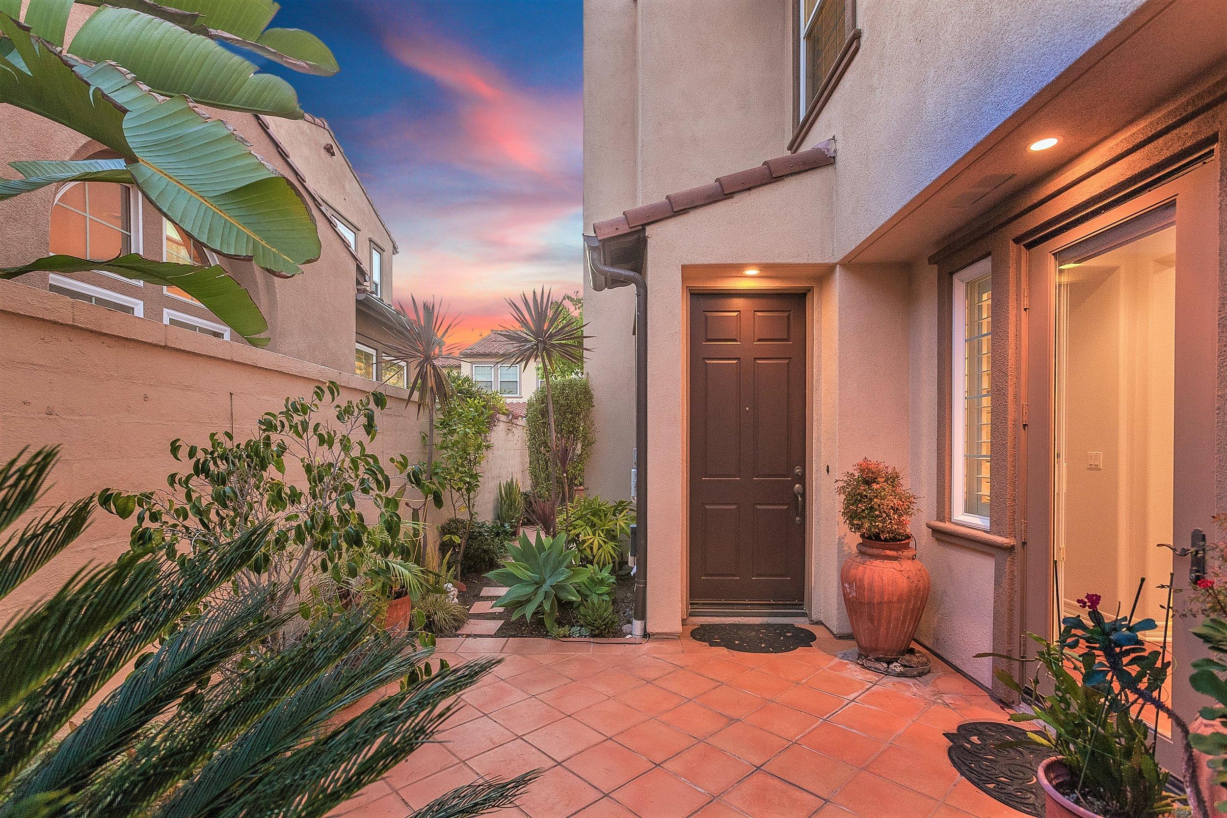 207 Tuebrose -Entry Courtyard @ Sunset.jpg