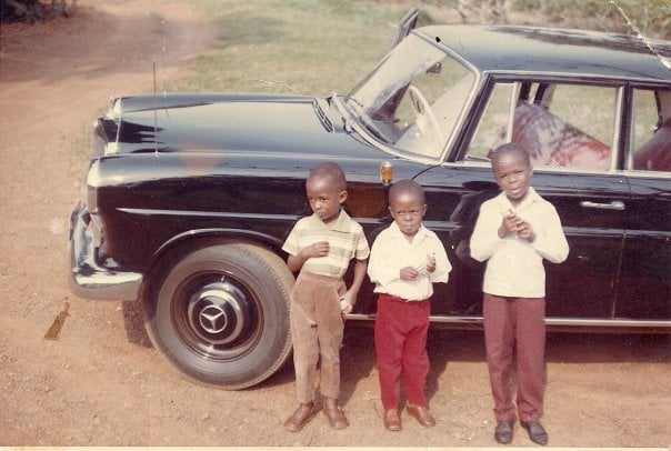 c. 1966 Samite (right) with his cousin Masembe (left) and his brother Mbaba (center)