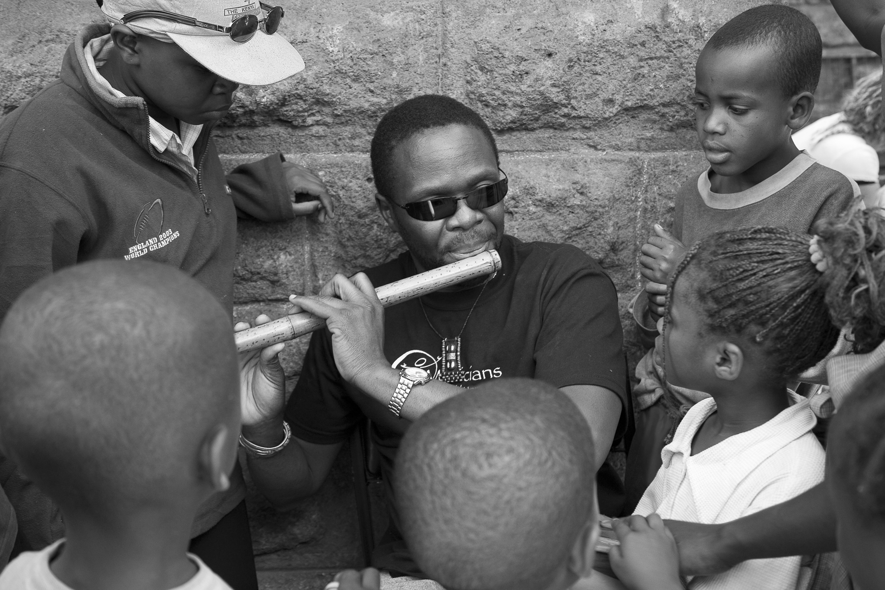 Samite Playing Flute at Shangilia.jpg