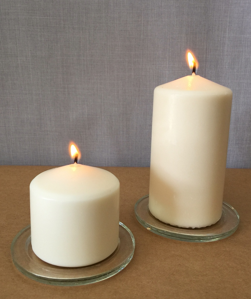 Pillar candles with glass saucer