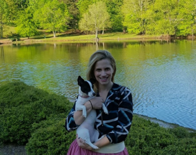 """Emily with her assistant therapist, her Jack Russell Terrier mix, """"Lumi"""" {Luminous}. Lumi is present at the majority of Emily's sessions."""