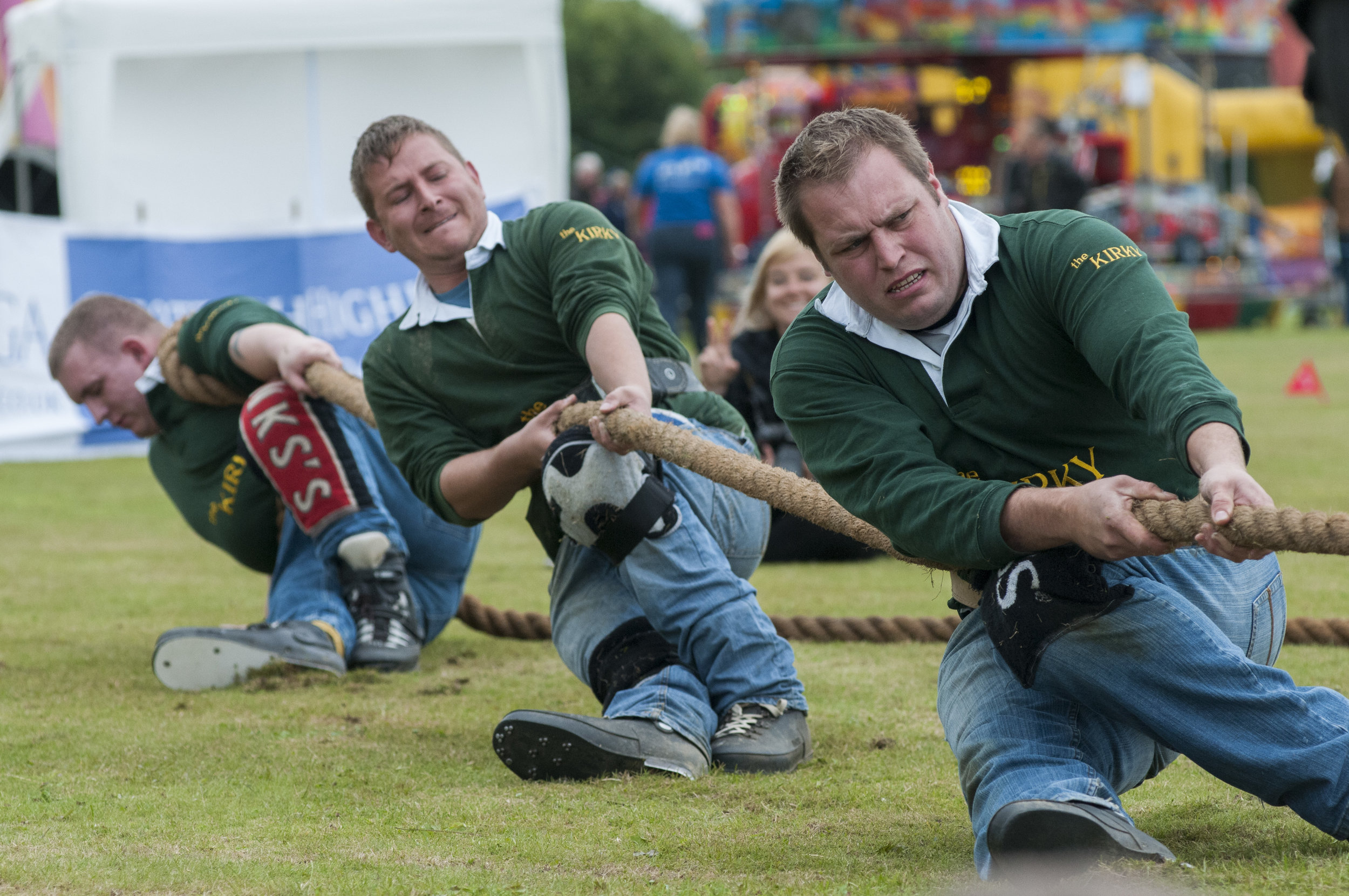 "Members of ""The Kirky"" team from Strathardle, Scotland compete in the tug-o-war event at the St. Andrews Highland games on July 26, 2015 in St. Andrews, Scotland."