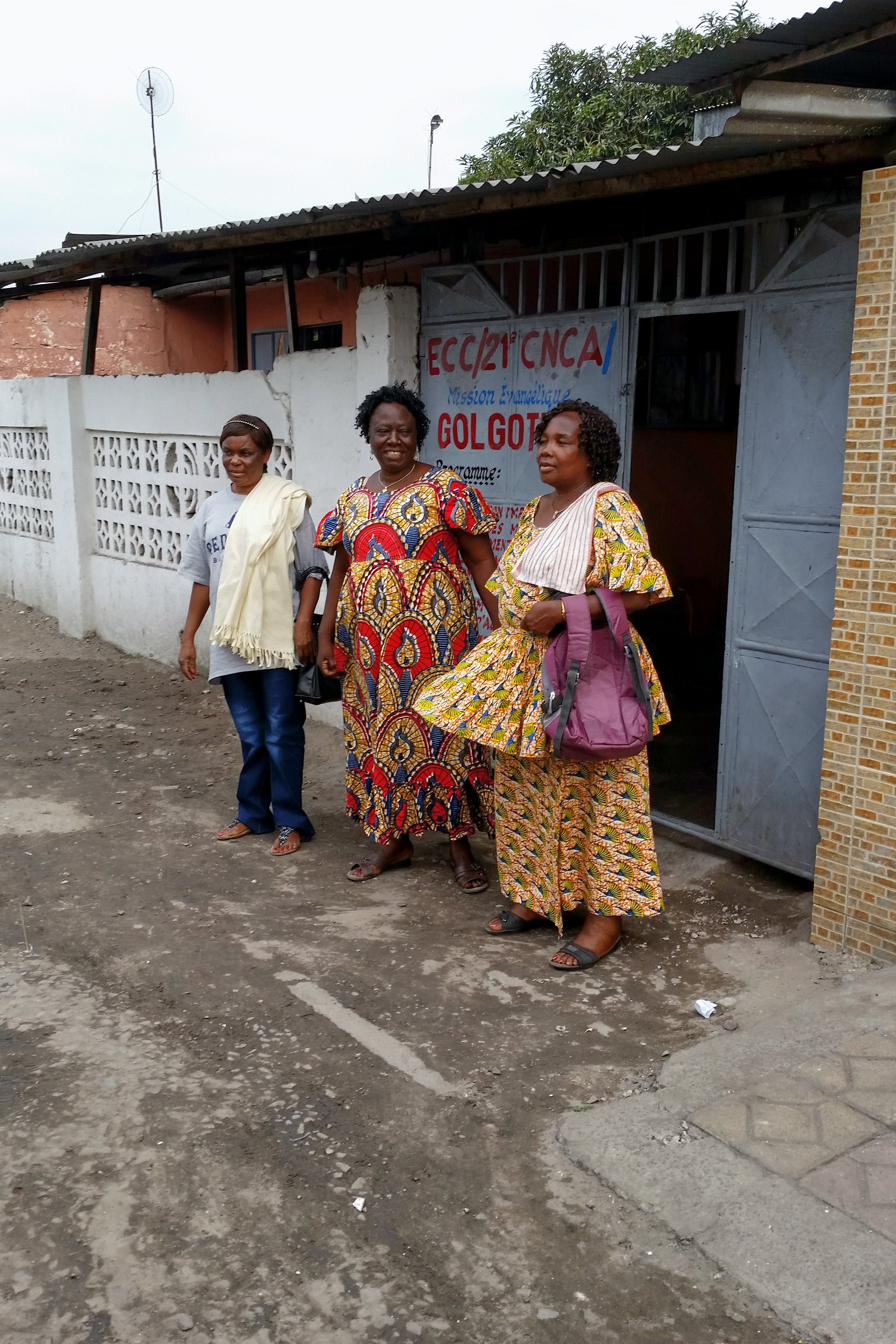 1d. Maman Monique (center) and friends in front of property.JPG