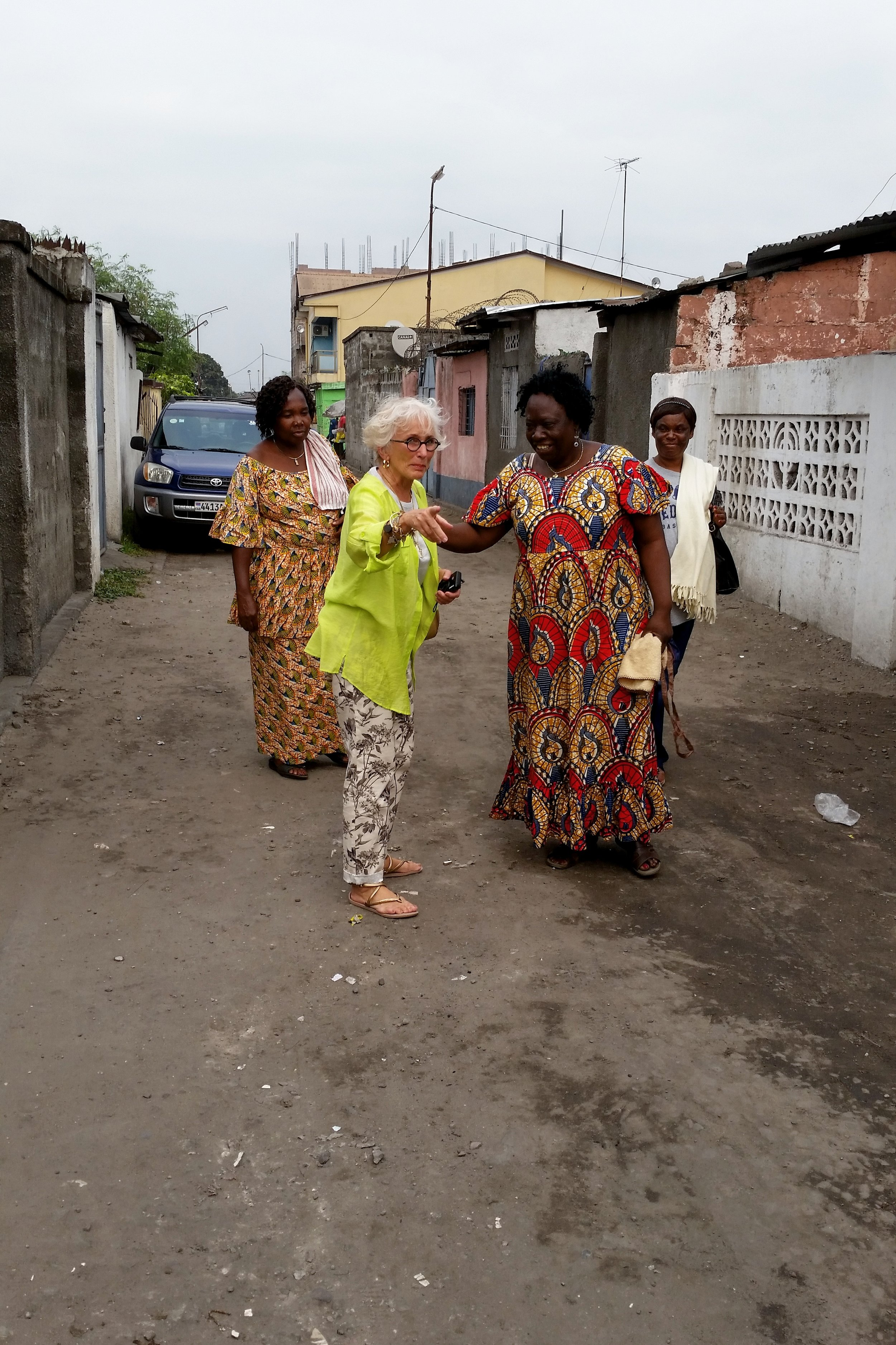 1a Maman Monique and friends arrive on the street with property to the right.JPG