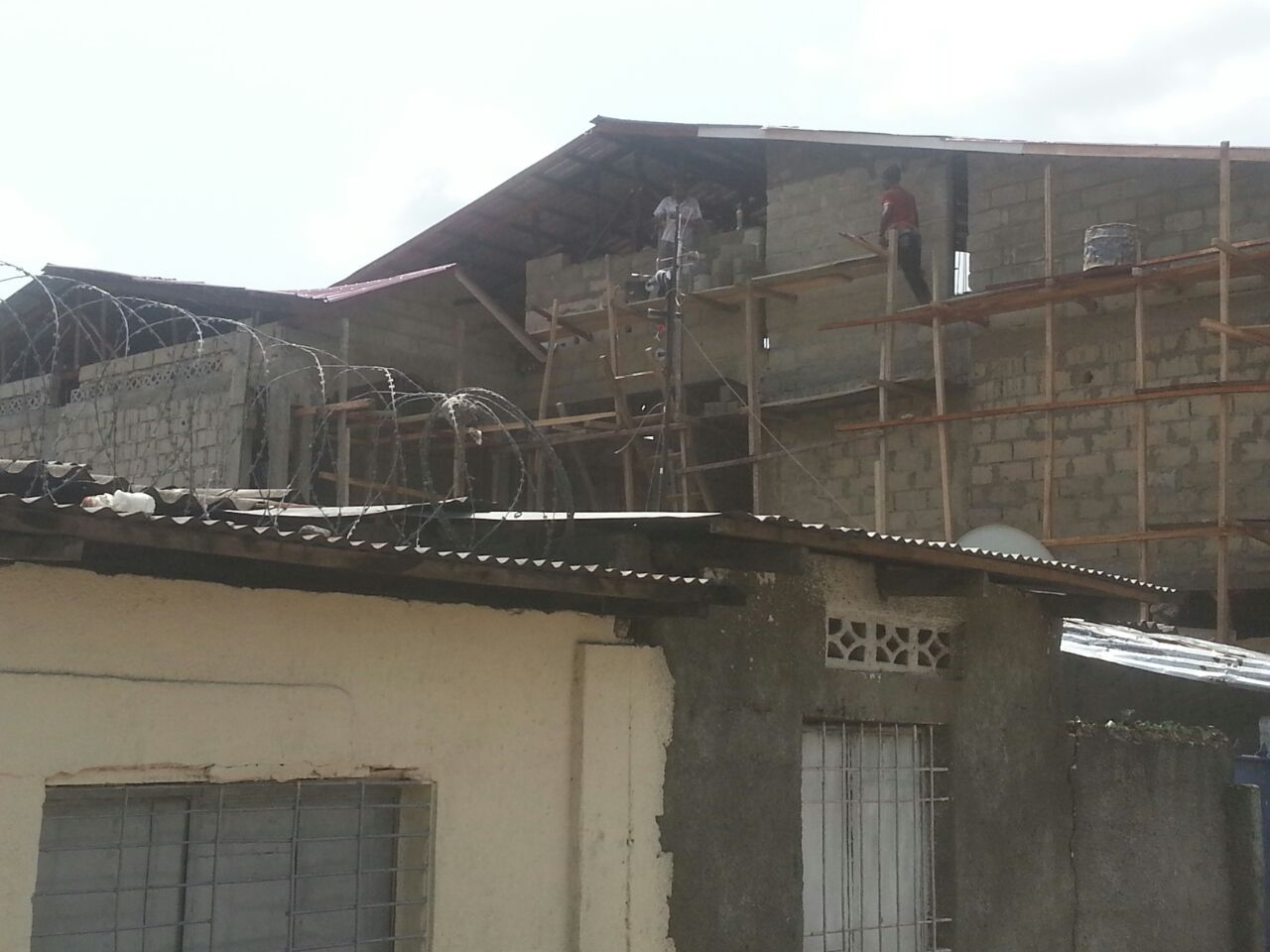5b completing exterior of 2nd floor (viewed over neighbor's roof) - Copy.jpg