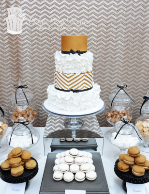 4 tier wedding cake ruffles chevron gold black white bow ribbon soft wedding cake.png