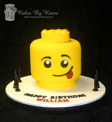 lego head cake silly face sticking out tongue cake cheeky.png