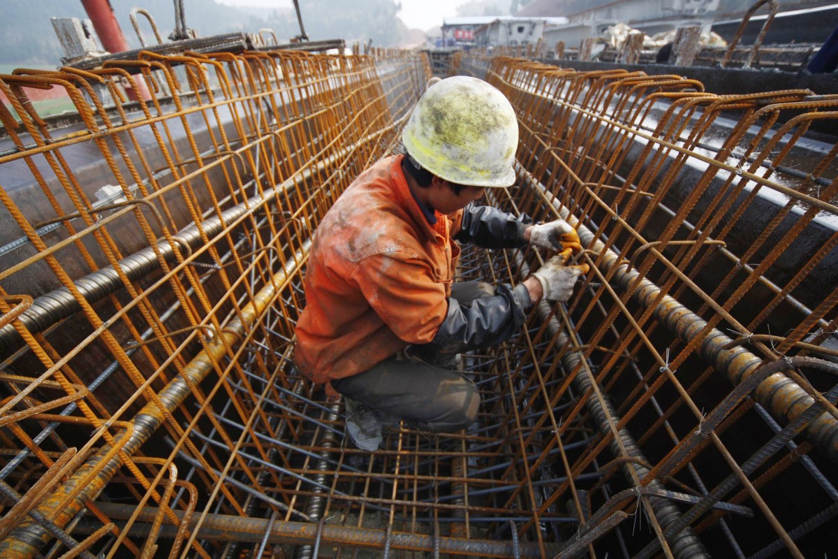 A Chinese laborer works at a railway construction site in Suining, southwest China's Sichuan province on March 5, 2011. (Photo: STR/AFP/Getty Images)