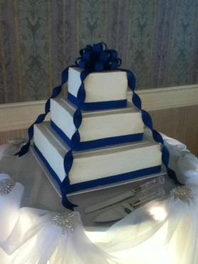 Photo by Mitchel's Cake & Dessert Company (This is NOT a fondant cake — only the blue parts are fondant while everything else is buttercream)