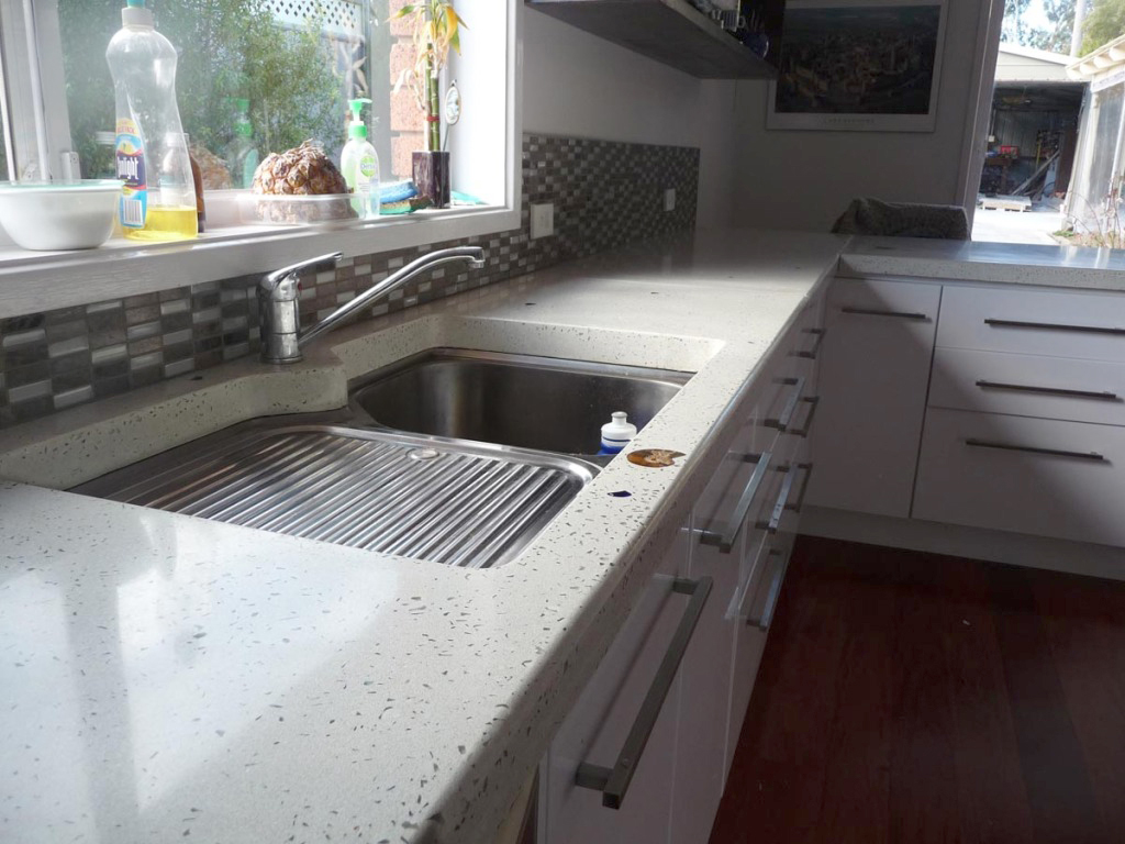 White benchtop with glass and fossils